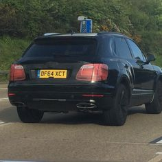 The rear view of the new Bentley SUV on test around the M25.