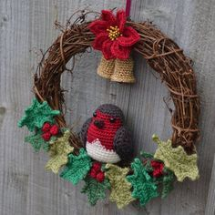 Crochet Christmas Wreath with Robin, Poinsettia, Holly and Bells that really 'ding'! Crochet Christmas Wreath, Crochet Wreath, Crochet Diy, Xmas Wreaths, Holiday Crochet, Christmas Knitting, Crochet Crafts, Crochet Flowers, Crochet Projects