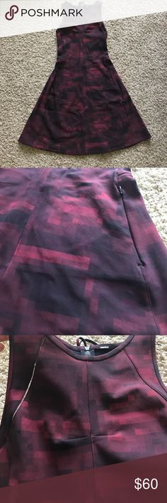 LULULEMON dress! Slight flare at bottom size 4 Maroon printed lululemon dress. Size 4, fitted then Flares slightly at bottom. Only WORN ONCE perfect condition lululemon athletica Dresses Asymmetrical
