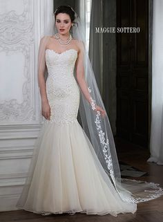 Dramatic lace fit and flare wedding dress with classic sweetheart neckline and organza skirt, Paulina Marie by Maggie Sottero.