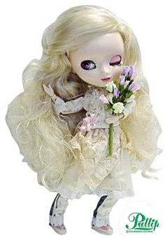 Pullip Bouquet September 2003 doll. Feel like I am in highland cottage, enjoying the beauty of the flowers. A Pullip type 1 body with visible screws, rooted long blonde hair, eyes are lavender color and have little compass stars in them, along with the white dot over the pupil. She has pink eye shadow with rose lips color. Outfit includes long sleeve blouse, ribbon tied, a lace and a ruched skirt worn under a denim jeans trimmed with lace cuffs with matching flower bouquet and hair clip.