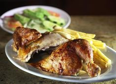 Somerville, MA 022015 Half chicken is served with salad and fries at Machu Chicken in Somerville, Friday, February 20 2015. (Wendy Maeda/Globe Staff) section: Lifestyle slug: 25pollo reporter: