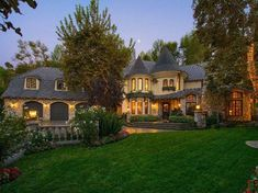 """Their Encino home is described as """"storybook country English,"""" complete with a copper turret entry and stone exterior. Description from realestateinsidernews.com. I searched for this on bing.com/images"""