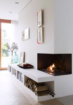 Are you looking for some amazing ideas for your new corner fireplace? Explore the top best corner fireplace designs featuring luxury angled interior ideas and inspiration. Fireplace Built Ins, Home Fireplace, Living Room With Fireplace, Fireplace Design, Home Living Room, Living Room Designs, Fireplace Ideas, Fireplace Modern, Corner Fireplaces