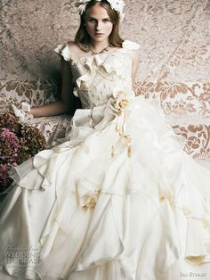 2011 Jill Stuart bridal wedding dress collection  - romantic gowns for princess brides.    I love the ruffled skirt and the flutter sleeves!!!