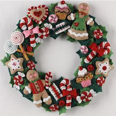 Bucilla ® Seasonal - Felt - Home Decor - Cookies and Candy Wreath. This collection is sure to bring the joy of the season to any room in your home. Christmas Wreath Image, Xmas Wreaths, Felt Christmas Ornaments, Christmas Gingerbread, Noel Christmas, Christmas Cookies, Felt Decorations, Christmas Decorations, Christmas Projects