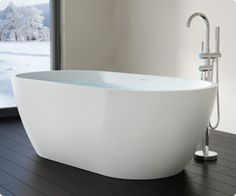 Quality and beauty come standard with the BW-02-XL freestanding modern bathtub. This stone resin stand alone tub features a perfect blend of modern styling and simple elegance for a timeless look that is both durable and easy to clean for years of bathing serenity. The modern design of this deep bathtub is met with lush depths that cradle you in warmth and luxury for a papering, full immersion experience. Crafted of acrylic polymer and natural minerals, this resin bathtub retains hea...