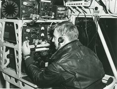 A U.S. Navy Airship Squadron 24 radioman at his station, written below the image, 'Weeksville Tower This is the King 28, Alert radioman prepares for day's activities'