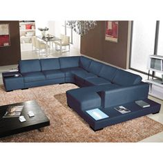 I really like this sofa, but it bugs me that it is really black and the photo shows blue. For $2500 you would think the color would be right!   @Overstock.com - Italia Designs Black Leather Sectional - This furniture set is made of solid hardwood and high density foam. The square back cushions on this sofa sectional are overstuffed for extra comfort.  http://www.overstock.com/Home-Garden/Italia-Designs-Black-Leather-Sectional/5549188/product.html?CID=214117 $2,559.99