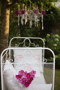 antique baby bed transformed into outdoor seating