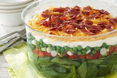 The classic potluck 7 layer salad is as good as ever, with layers of veggies, bacon and cheese. This is what layered salad recipes are all about!