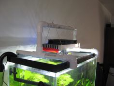 Advices for a hanging light stand for aquarium. Diy Aquarium Stand, Home Aquarium, Aquarium Fish, Aquarium Ideas, Hanging Bar, Hanging Lights, Best Fish For Aquaponics, Aquaponics Garden, Ideas