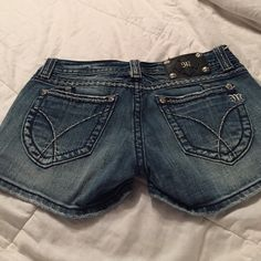 Miss Me Denim Shorts These blue jean shorts have been worn a handful of times. They have a few stitching coming out but overall great condition. They are a size 28 but fit as if they were a size 29. Purchased from Buckle Miss Me Shorts Jean Shorts