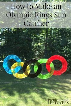 Olympic Rings Sun Catcher Craft- This colorful sun catcher displays the five Olympic rings. It's a fun and easy craft to make with kids during the Olympics.