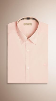 A straight fit shirt in cotton poplin woven with elastane for added  comfort. The easy b37250f9a3b4