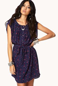 Floral dress from F21 would look cute for fall with black tights,mustard cardigan and dark brown boots