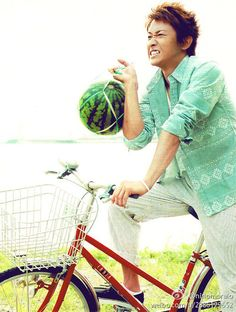 Satoshi-kun on a bike. With watermelon?!