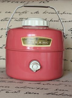 pink vintage Knapp Monarch Therm-A-Jug.  We had a taller one... I think it was red and white.