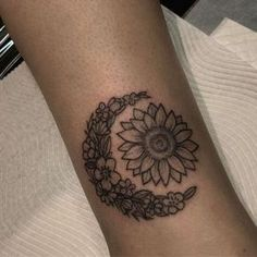 floral sun and moon tattoo