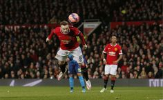 Manchester United's Wayne Rooney scores their first goal