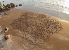 Amazing beach sand art by Andres Amador. Slideshow.