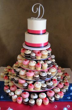 Pink Wedding Cakes Like this except the cupcakes in their individual holders to be taken home if they want. =) Just diff colors. Hot Pink Cupcakes, Wedding Cakes With Cupcakes, Holiday Cupcakes, Cupcake Rosa, Cupcake Cakes, Cupcake Ideas, Cup Cakes, Trendy Wedding, Dream Wedding