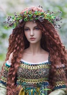 This woman makes absolutely gorgeous art dolls!! She is Martha Boers and her site is called Antique Lilac.