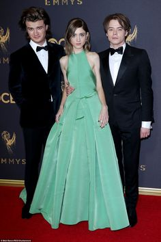 Focused: Her co-star Natalia Dyer, also 20, chose a lime green dress by Vera Wang Collection, adding Jimmy Choo shoes; pictured with Joe Keery (l) and Charlie Heaton (r) - both are on the show as well