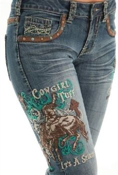 Cowgirl Tuff Company Unbelievable Spirit Jeans are stitched in turquoise cream and brown and accented with faux leather patches and brown and turquoise studs. The back pockets have the signature barbe Cowgirl Jeans, Cowgirl Mode, Western Jeans, Cowgirl Bling, Cowgirl Outfits, Cowgirl Style, Western Outfits, Western Style, Cowgirl Jewelry
