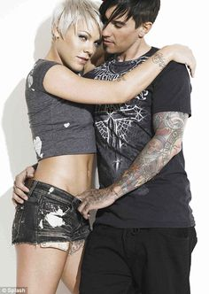 Carey Hart -- His hottest pics are with his wife Pink which I think is awesome!! They make each other hot!