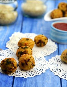 Crispy Rice Balls, cooked rice and colourful vegetables are used to make a mildly spiced dough that is shaped into balls and deep-fried. This is a wonderful way to include veggies into your kids' diet.