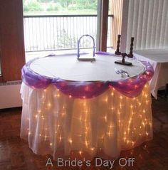 Cake table decor. I like the lights. Navy blue instead of purple.another i wish i would have known for my wedding .. oh well it was all i could of have for <3