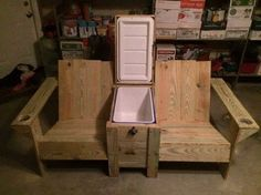Wood Bench wth a cooler in the middle and cupholders on the armrest