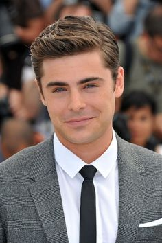 Zac Efron, in a grey suit.