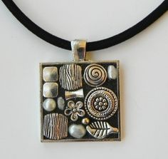Silver mosaic pendant with velvet cord by ClearlyCaroline on Etsy, $23. A silver mosaic pendant with black grouting, silver beads and gray and white pearls Size: 1 inch square.