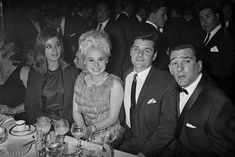 30 April 1965: Actress Barbara Windsor and her husband Ronnie Knight sit with Reggie Kray and his wife Frances Shea at the El Morocco nightclub in Soho, owned by the Kray Twins.(Larry Ellis/Daily Express/Hulton Archive/Getty Images)