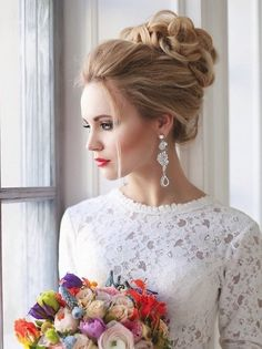 wedding top bun updo hairstyle for brides / http://www.deerpearlflowers.com/beautiful-wedding-hairstyle-ideas/