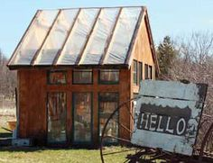 This homemade greenhouse was made from locally sourced lumber, recycled windows & plastic top. (motherearthnews)
