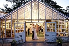 bride and groom's first dance - late evening, greenhouse wedding reception - wedding photo by top Swedish photographer Lena Larsson