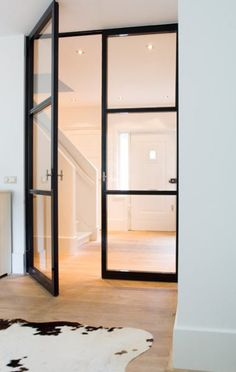 These big glass and steel doors are great because of their height and the light they let through. We also like that they are obviously custom and created specifically for this space.
