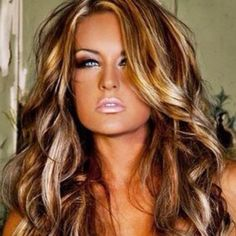 This chick is way too orange, but I kind of like her hair. A decent compromise between brown and blonde.