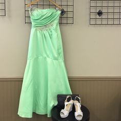 Masquerade Lime Prom Gown Strapless lime green prom dress with rhinestone detail. One rhinestone missing. Price negotiable. Slight mermaid style. Gathering around bodice. Masquerade Dresses Prom