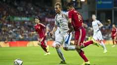 Norbert Gyömber of Slovakia in action with Diego Costa (R) of Spain during their UEFA EURO 2016 qualifier