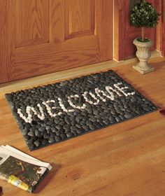 I could MAKE this... or I could buy it. Lazyness would probably win out. Natural Pebble Doormats $12.32