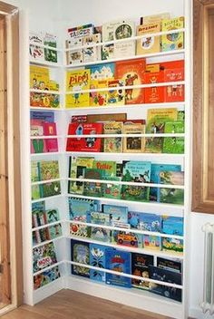 I just love this way of storing books. If your child can see all their books, they're more likely to want to read them! I need to figure out a way to make this work in my house!