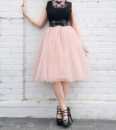 If Carrie Bradshaw can rock a tutu in NYC, you can rock one anywhere. This gorgeous non-stretchy skirt has 6 layers of semi-sheer tulle, satin