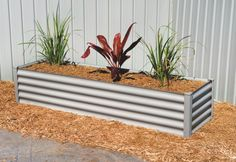 Rectangular Raised Garden 200cmW x 55cmD x 41cmH Zincalume without measurements.  Hexies. PVC posts. No screws.