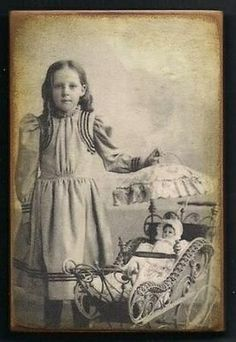 Vintage photo of a little girl with her doll....