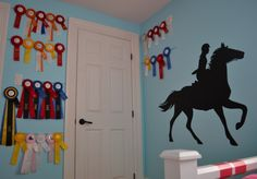 horse room.   displaying horse show ribbons