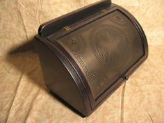 A kettleblack punched tin and distressed wooden bread box